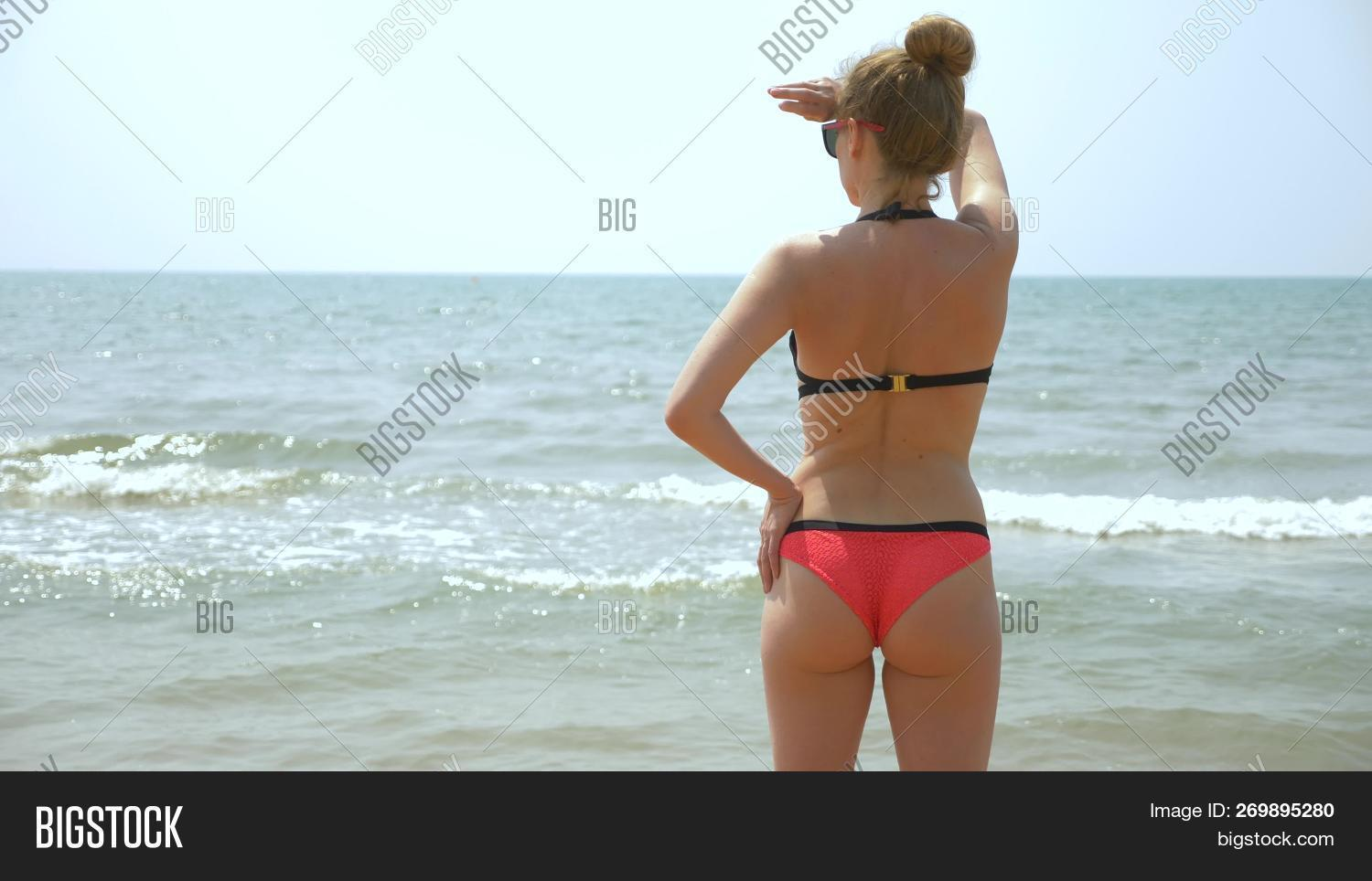Beautiful young girls with nice butts on the beach