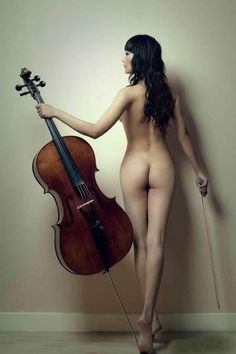Nude females with instruments